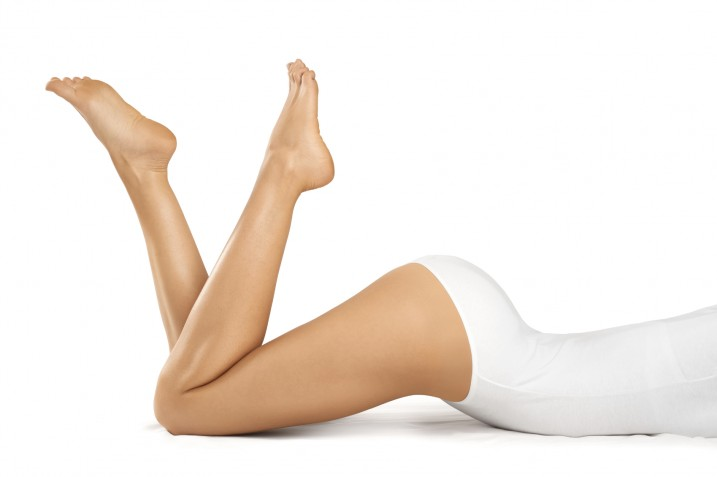 Beautiful woman legs on a white background. Body care.